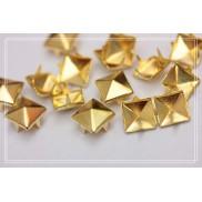 Borchie a piramide alette diametro 8mm colore oro